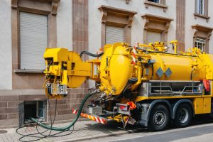 Grease trap pumping truck
